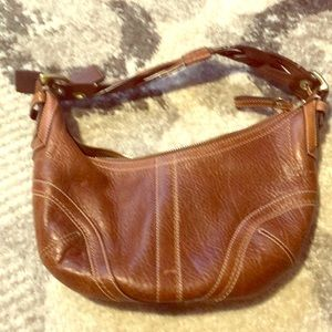 Natural brown leather coach bag.   Small